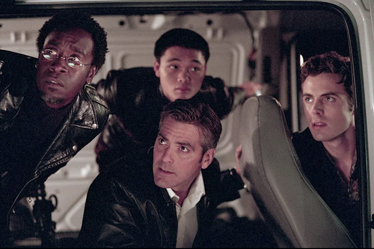 Don Cheadle, George Clooney, Shaobo Qin, and Casey Affleck in a scene from 2001's Ocean's Eleven.
